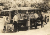 Adults browsing at a bookmobile for Cincinnati and Hamilton County in Ohio.