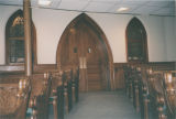 Sanctuary pews, arched door, and windows at the First Baptist Church in Selma, Alabama.