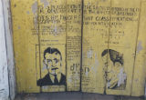 "John Dillinger ""wanted"" sign painted on the door of the Smuteye Grocery in Bullock..."