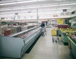 Refrigerated cases beside the produce section at the Kwik Chek store on Atlanta Highway in...