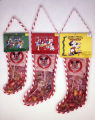 Candy-filled Christmas stockings produced by the American Candy Manufacturing Company in Selma,...