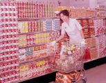 Woman shopping at Wise Super Market in Montgomery, Alabama.