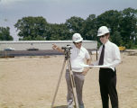 Employees of OWC Limited of Montgomery, Alabama, surveying a property.