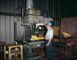 Employee working at Robinson Foundry, Inc., probably in Montgomery, Alabama.