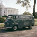 Dixie Electric Company van parked beside the State Capitol on Washington Avenue in downtown...