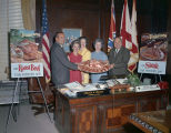 Governor Lurleen Wallace and members of the Alabama Cattlemen's Association with platters of beef...