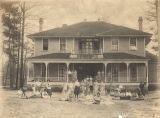 Students gathered outside Esther Home, the first dormitory at the Downing Industrial School for...