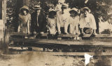 Group of young men and women on the campus of the Downing Industrial School for Girls in Brewton,...