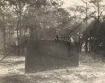 African American soldiers scaling a wall during training at Brookley Field in Mobile, Alabama.