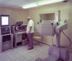 Technician operating a large piece of scanning equipment at Jackson Hospital in Montgomery,...