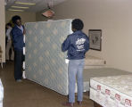 Employees moving a mattress at the La-Z-Boy Showcase Shoppe in Montgomery, Alabama.