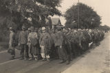 German prisoners preparing to march to the POW camp from the train in Aliceville, Alabama.