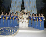 Queen and attendants on stage at the Krewe of the Athenians Ball at Garrett Coliseum in...