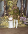Man and child at the Krewe of the Athenians Ball at Garrett Coliseum in Montgomery, Alabama.