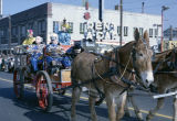 Mule-drawn cart in the Krewe of the Phantom Host parade on Montgomery Street in Montgomery,...