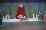 King and queen on stage with their court at the Krewe of the Phantom Host Ball at Garrett Coliseum...