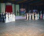 Attendants standing in front of the stage at the Krewe of the Phantom Host Ball at Garrett...