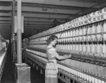 Woman operating a thread machine at the West Boylston Manufacturing Company in Montgomery County,...