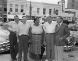 Men standing with Mrs. Minnie B. Guice on Commerce Street in downtown Montgomery, Alabama, before...