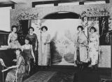 Copy photograph of Zelda Fitzgerald and other young women in front of a stage.