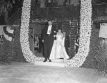 Governor Jim Folsom and his wife, Jamelle, entering the arena for the Grand March during his...