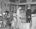 Member of the Salvation Army collecting cans of food during a children's movie at the Paramount...