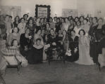 Members of the Vesta Art and Literary Club in formal dress, gathered for the club's 21st...