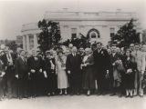 Helen Keller with President Herbert Hoover, Mrs. Hoover, and others in front of the White House.