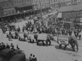 Copy photograph of a circus parade down Lee Street in downtown Montgomery, Alabama, past the...
