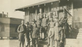 Men standing in front of Barrack 23 at Camp Sheridan in Montgomery, Alabama.