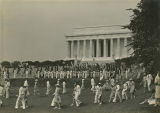 Members of 4-H clubs marching in front of the Lincoln Memorial during a citizenship ceremony in...