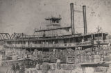 "Unloading cotton from the steamboat ""R. C. Gunter"" at Decatur, Alabama."