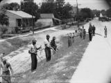 Prisoners leaving the jail in Phenix City, Alabama, probably on their way to work.