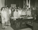 Lurleen Wallace standing with a group of teenagers in her office at the Capitol in Montgomery,...