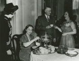 Woman serving coffee to guests from a silver urn during the inaugural open house of the Governor's...