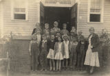 Fourth grade class on the front steps of a school in Weogufka, Alabama.