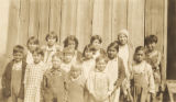 Group of children in front of a school administered by the Poarch Band of Creek Indians in...