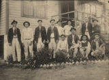 Group of men standing in a flower bed in Flat Top, Alabama.