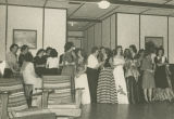Photographs of a dance at the American officers' club at the POW camp in Aliceville, Alabama.