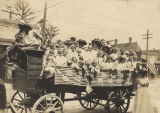 "Children and adults in the back of a wagon, ready for the ""Annual Kindergarten Picnic""..."
