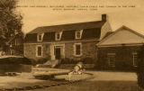 """Mallory and Wendell Buildings. Historic chain cable and cannon in the yard. Mystic Seaport,..."