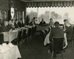 Members of the Alabama Sesquicentennial Commission at a lunch meeting in a restaurant.