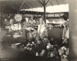 Young woman arranging flowers at a curb market in Montgomery, Alabama.