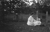 Martha Simpson with a baby in the yard of the Simpson home in Furman, Alabama.