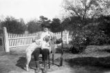Lawrence Waverly Simpson with his dog, Dan, probably in the yard of the Simpson home in Furman,...