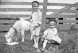 William and Hugh Simpson, with a goat in front of a wooden fence in Furman, Alabama.
