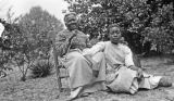 Sarah and Willy Ann, African American women, seated in a dirt yard, probably in Furman, Alabama.