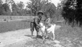 Two African American children with a goat in rural Wilcox County, Alabama.