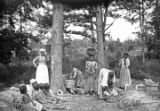 African American women and children washing clothes in rural Wilcox County, Alabama.