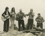 Band standing on a rock formation at Horse Pens 40 in St. Clair County, Alabama.